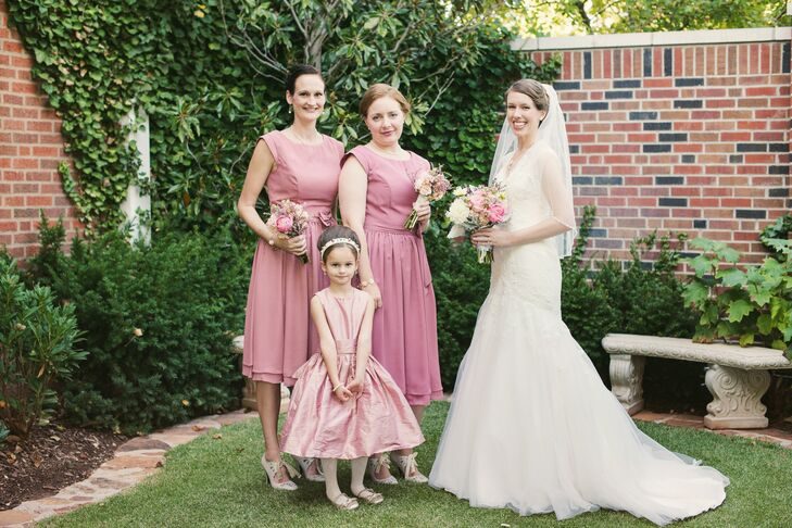 """Chelsea's maid of honor and bridesmaid wore dusty rose short-sleeve dresses and carried matching whimsical bouquets. Her """"bride announcer"""" wore a dusty rose dress with a sophisticated updo and headband to match the elegant, vintage style."""