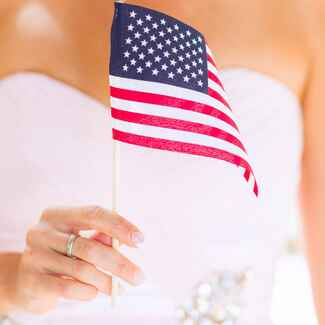 Bride holding American flag