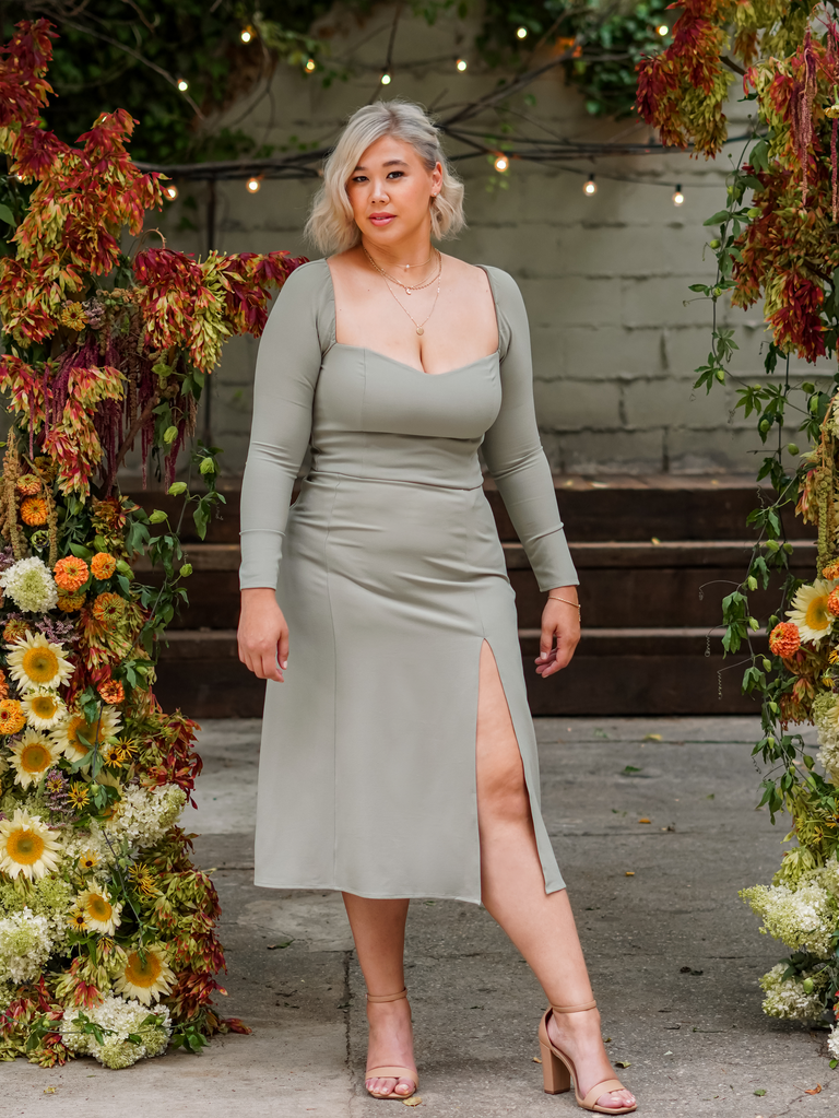 """Abercrombie x The Knot's """"Best Dressed Guest"""" Collection sage green long sleeve top and midi skirt with slit"""