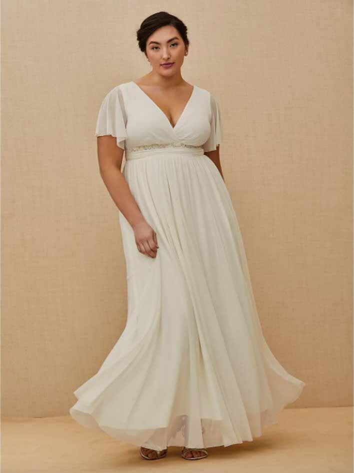 Simple white wedding dress with flutter sleeves, V-neckline and empire skirt