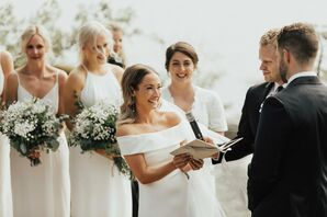 Classic Bride and Bridesmaids with White Gowns and Baby's Breath Bouquets