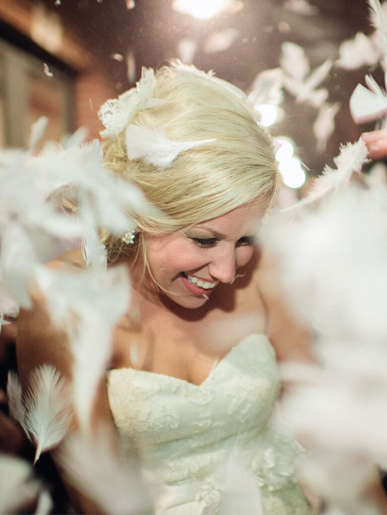 White feathers for a creative wedding exit toss idea