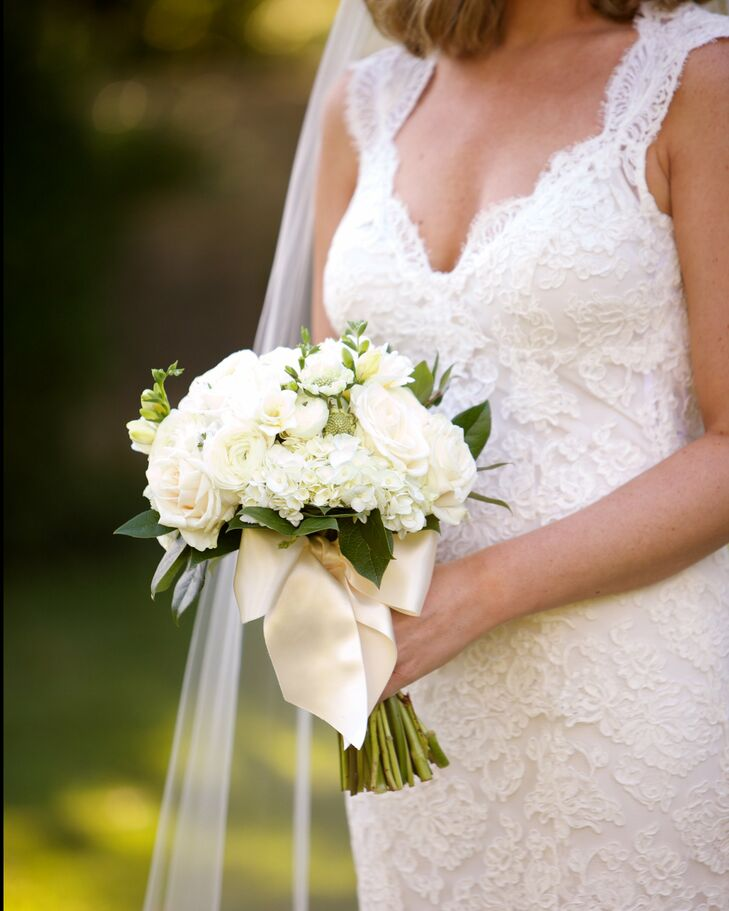 """""""It was a black-tie wedding, but we didn't want the stuffy feel of a black-tie event,"""" Alex says. She carried cream roses, white hydrangeas, ranunculus, freesia, scabiosa and sweet William because she """"married a sweet William."""""""