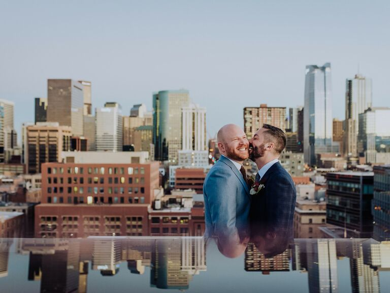 Couple laughing kissing on cheek