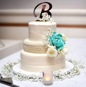 White Wedding Cake With Teal Cake Flower