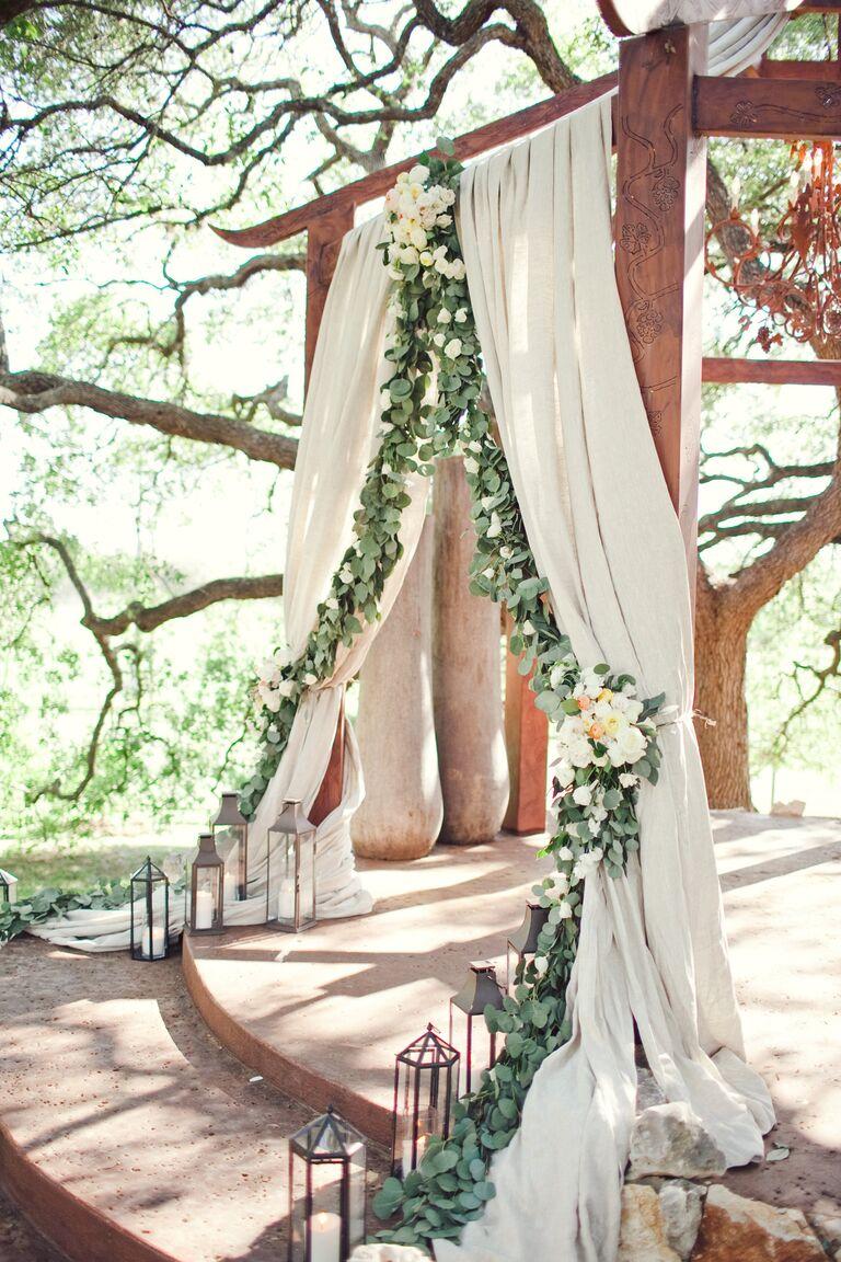 Wedding ceremony arbor with eucalyptus garland