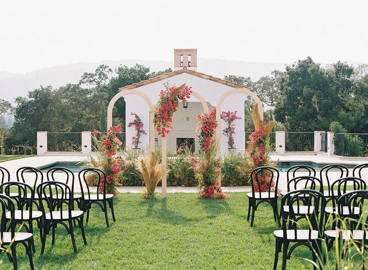 Wedding Ceremony With Triple Arch and Bentwood Chairs