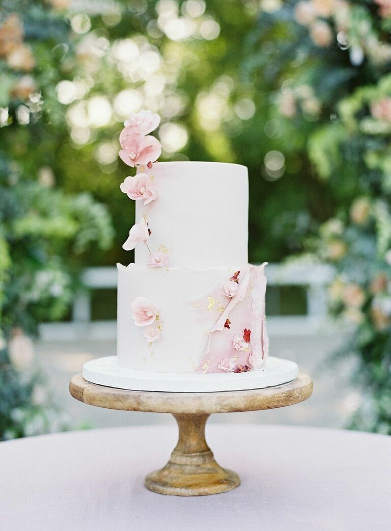 Romantic two-tier wedding cake with pink flowers