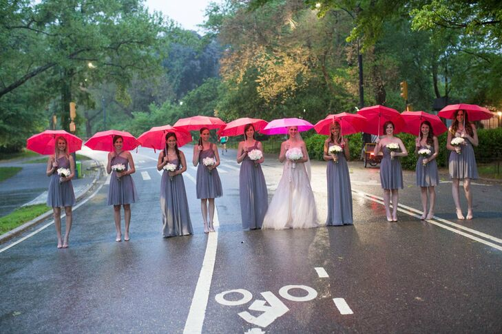 """""""Any bride can imagine my disappointment when I saw the five day weather forecast called for a 100% chance of rain on my wedding day, but funny enough, I am so happy it did rain!"""" Jessica says. She and her bridesmaid took photos under pink umbrellas."""