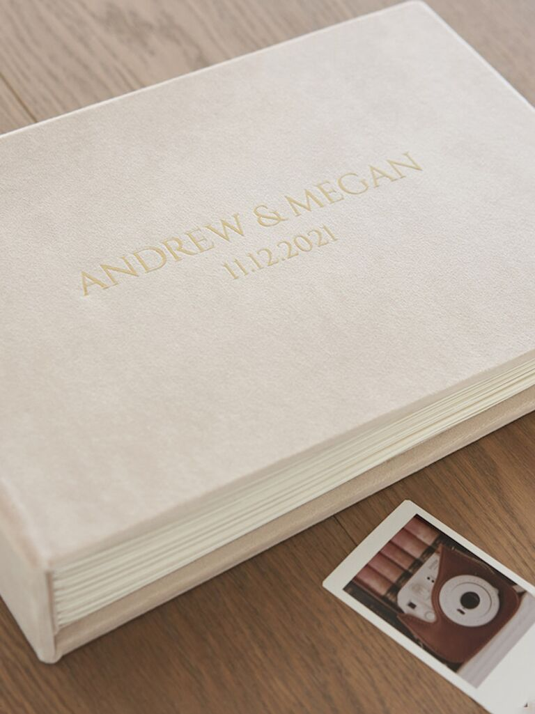 etsy cream wedding guest book idea with polaroid slots