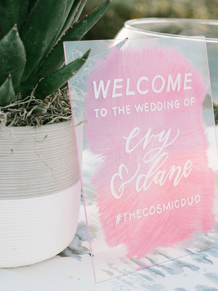 Modern Acrylic Sign with Pink Watercolor Background and White Typography