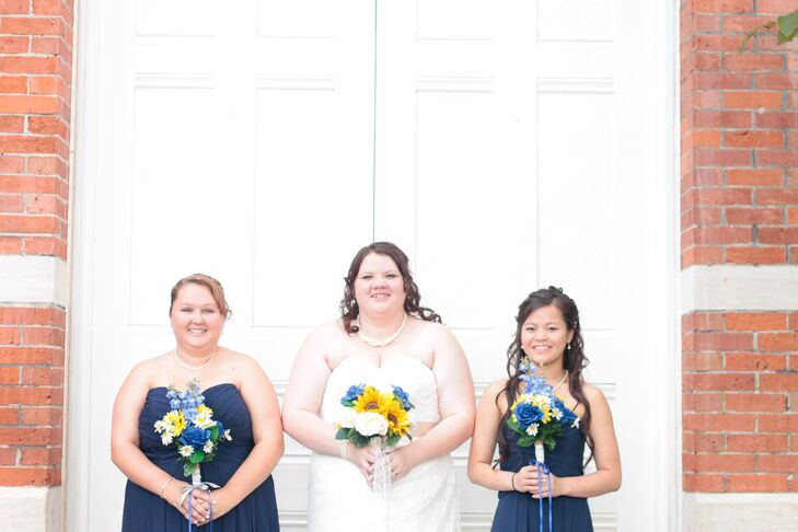 Alisha's bridesmaids wore navy dresses and carried simple wildflower-inspired bouquets.