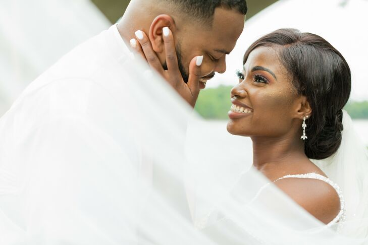 Bride and Groom Portraits With Veil at Stone River in Columbia, South Carolina