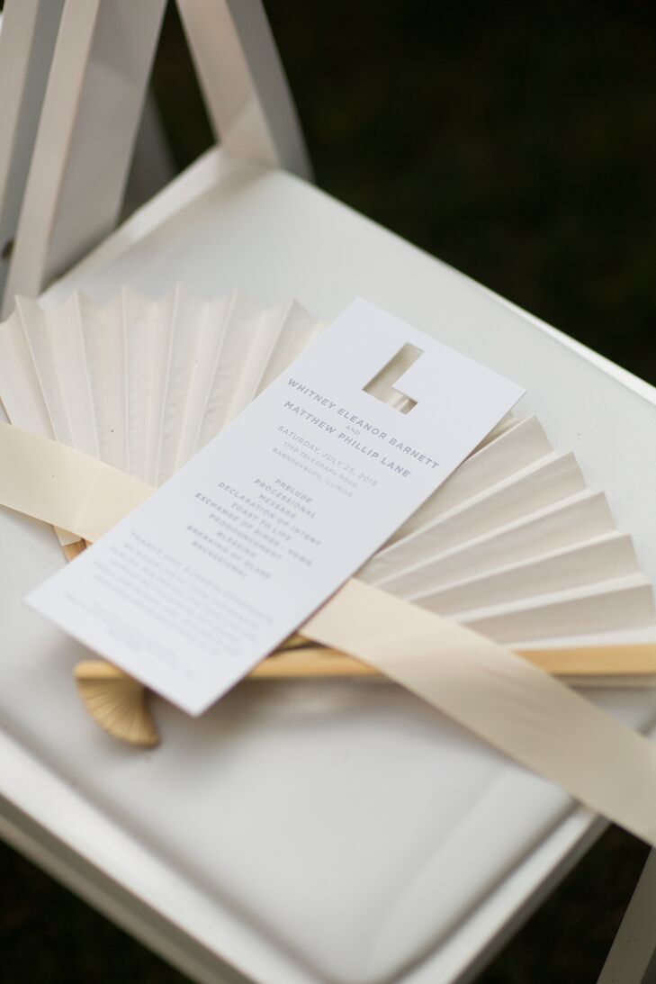 """As a nod to Whitney's new surname, a laser-cut """"L"""" was used to decorate the save-the-dates and ceremony programs."""
