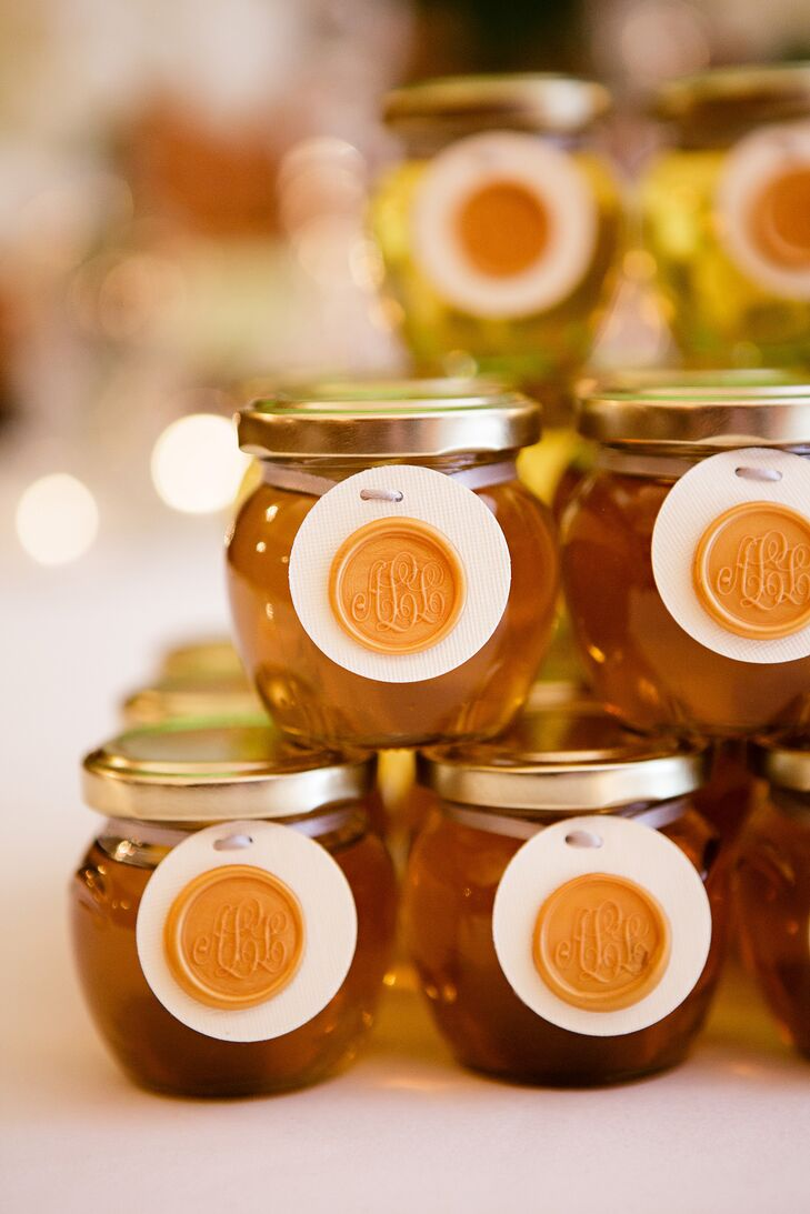 """Post-reception, the newlyweds passed out jarred honey favors with a wax monogram of their initials. """"The honey came from the hive of the groom's mother, so it was jarred with love,"""" the bride says."""