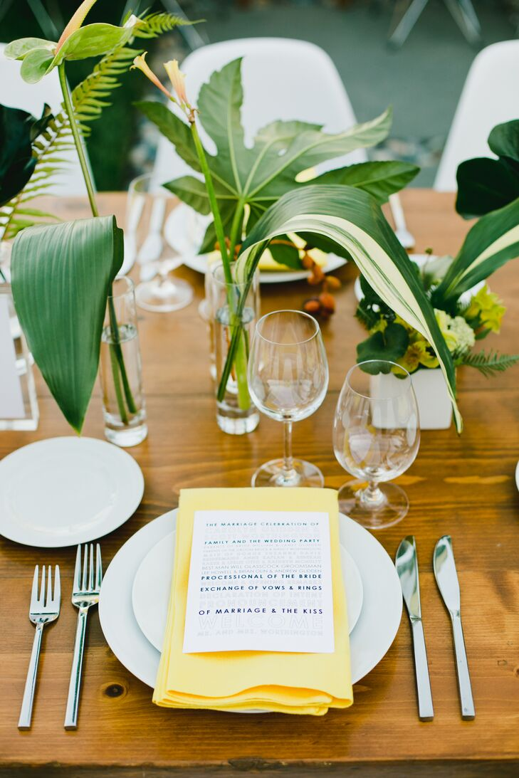 At the reception, long wooden banquet tables were topped with clear vases of fresh fernlike greens. Yellow napkins added a pop of color.