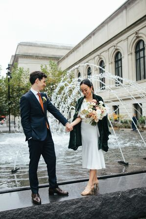 Couple Holding Hands by Fountain in Front of Metropolitan Museum of Art in New York City