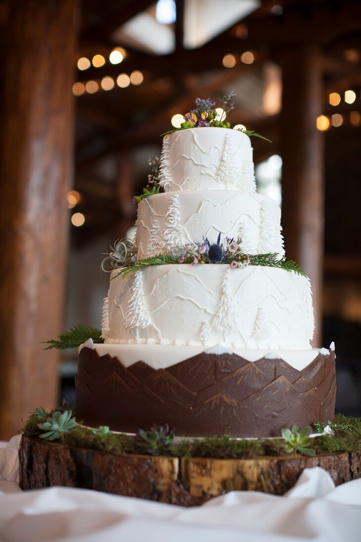 """""""One of the special highlights of selecting Keystone as our venue was the ability to work with chef Ned Archibald in creating a one-of-a-kind cake,"""" David says. Layers of double-chocolate Reese's Peanut Butter Cups truffle fudge with feuilletine gianduja and devil's food cake and tres leches sponge cake with strawberries, apricot jelly and raspberries were decorated to the nines with fondant mountains and evergreen trees, as well as fresh herbs, flowers and berries."""