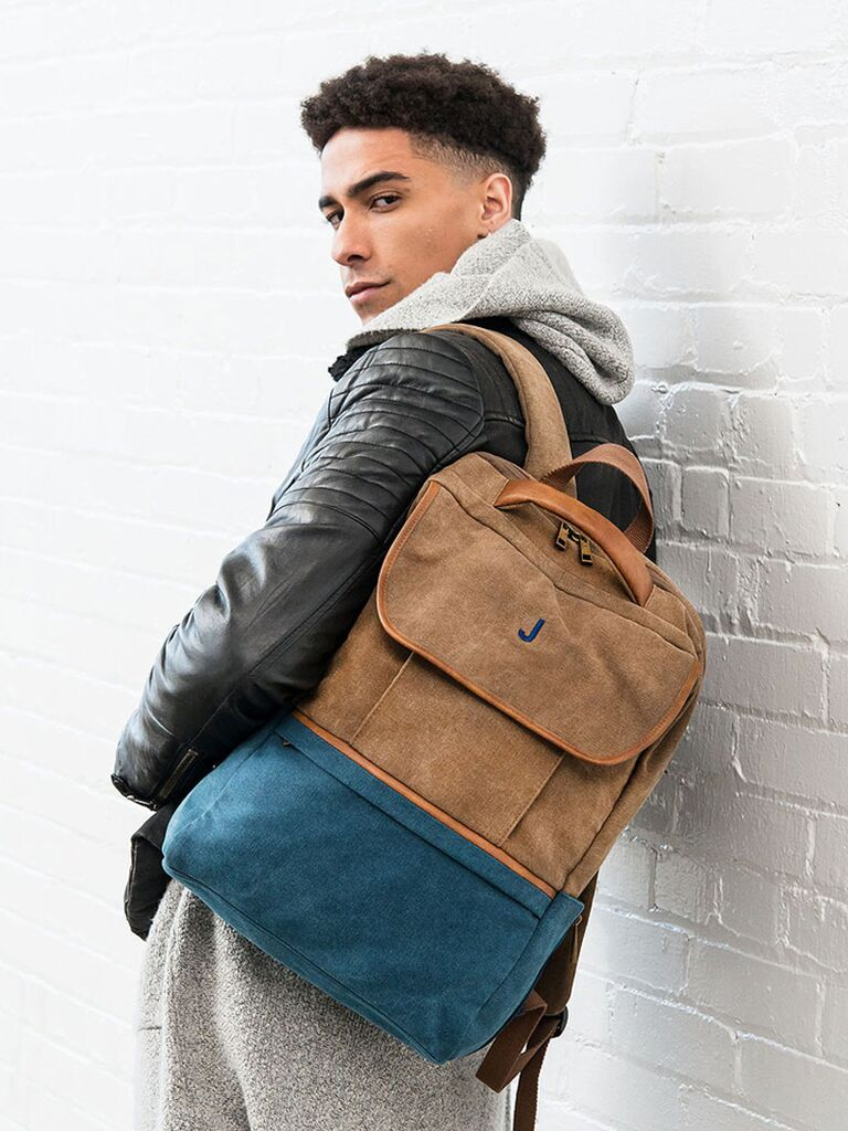 Brown and blue faux leather backpack with blue initial