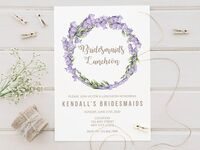 Purple flower and greenery wreath with playful gold type on white background