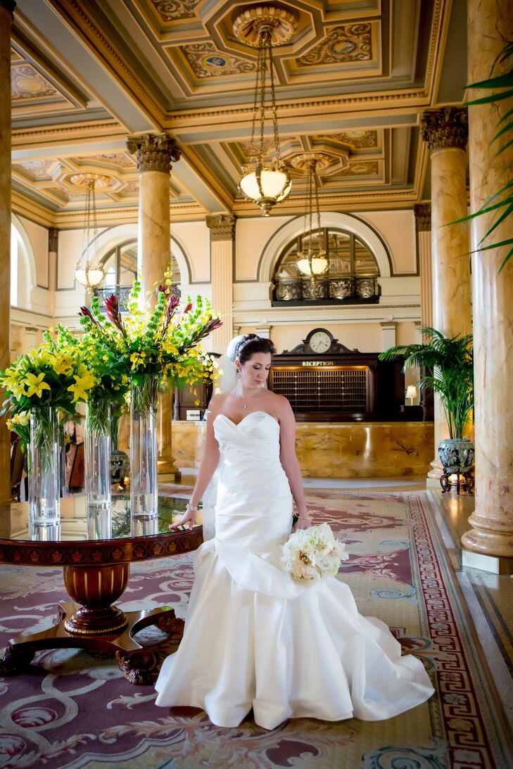 Beth wore a stunning mermaid style Martiana Liana wedding dress with a double stranded diamond headpiece to her hotel wedding.