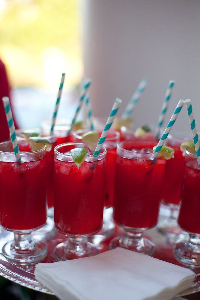 Red and Lime Signature Cocktail With Blue Striped Straws