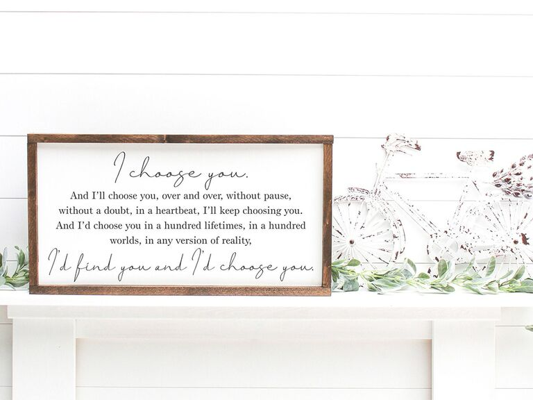 'The Notebook' quote in black minimalist type on white background in wooden frame