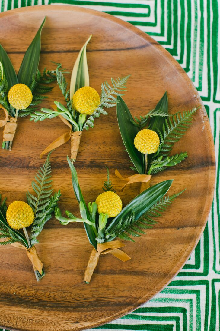 """Hawthorn Flower Studio brought Carolyn's modern, colorful vision to life. """"As the main decoration of our wedding, the flowers made everything look amazing,"""" says Carolyn, who chose simple golden mimosas for the boutonnieres."""