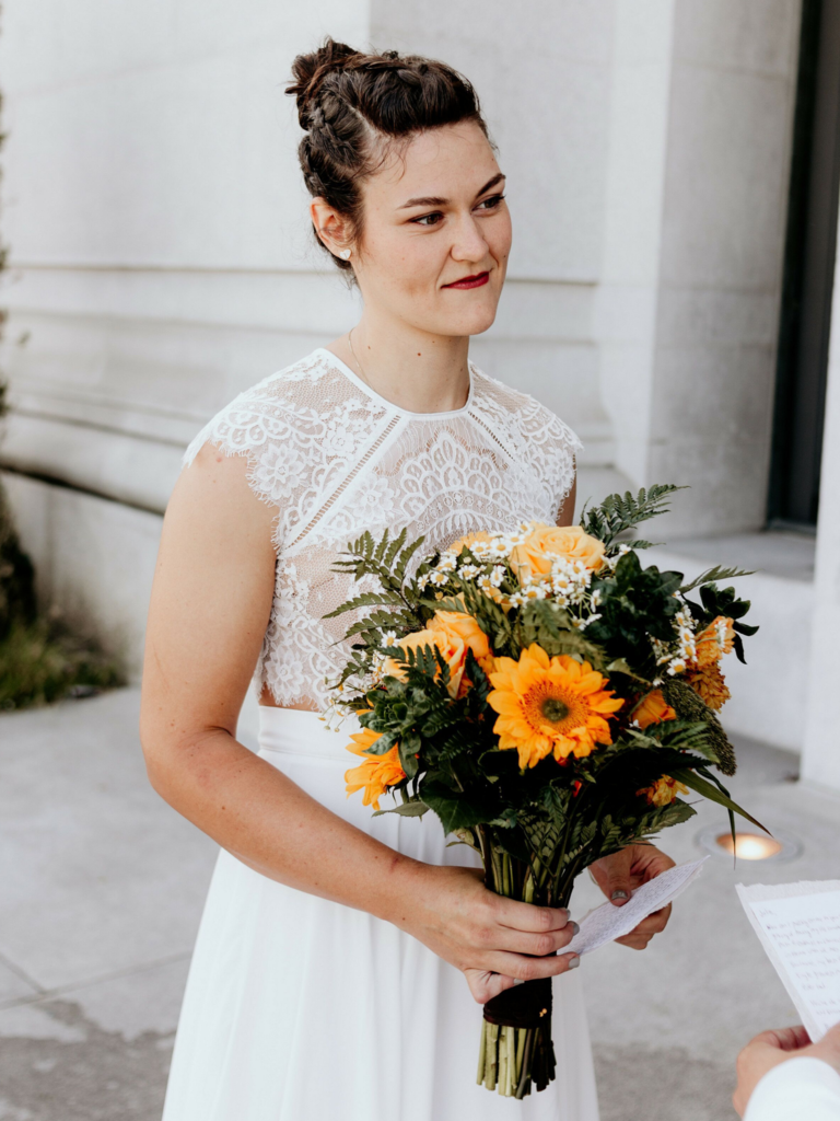 To-be-wed holding bouquet with yellow Gerbera daisies