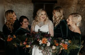 Bride and Bridesmaids Carry Cascading Bouquets at Moody Rustic Wedding
