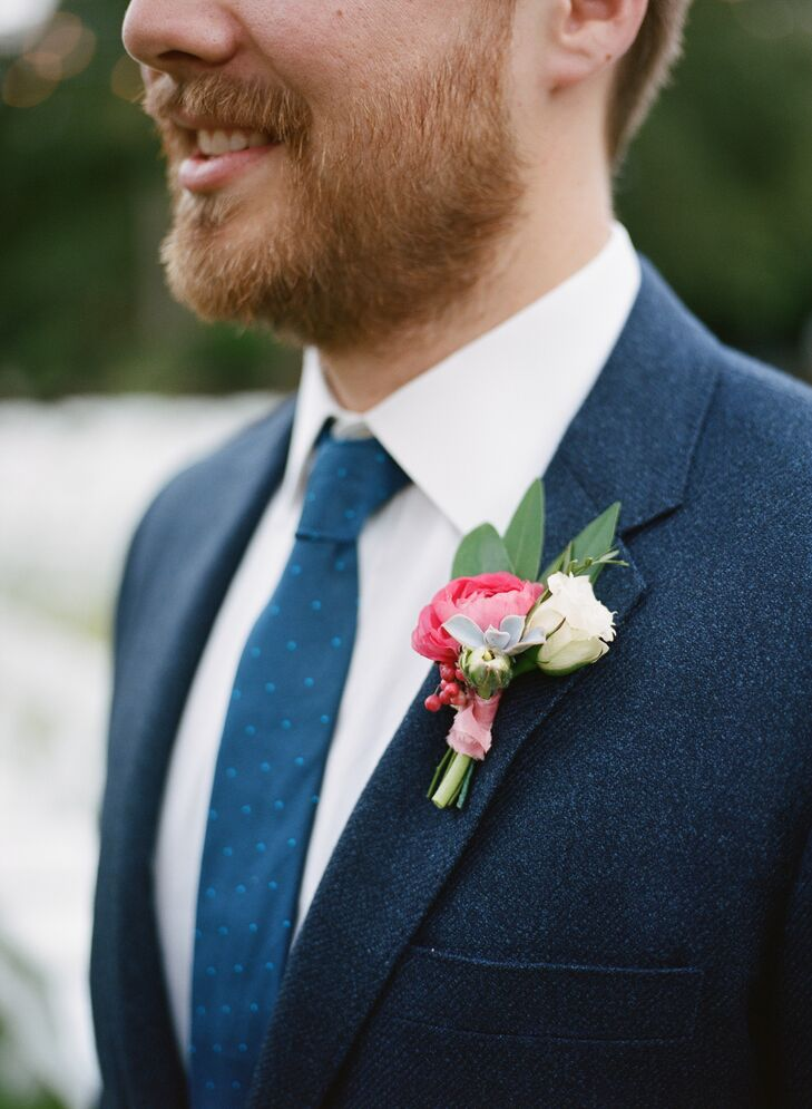 Ian and his groomsmen embellished their suits with pink ranunculus blossoms and greenery.