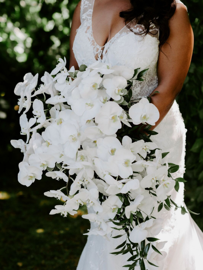 White cascading bouquet with orchids