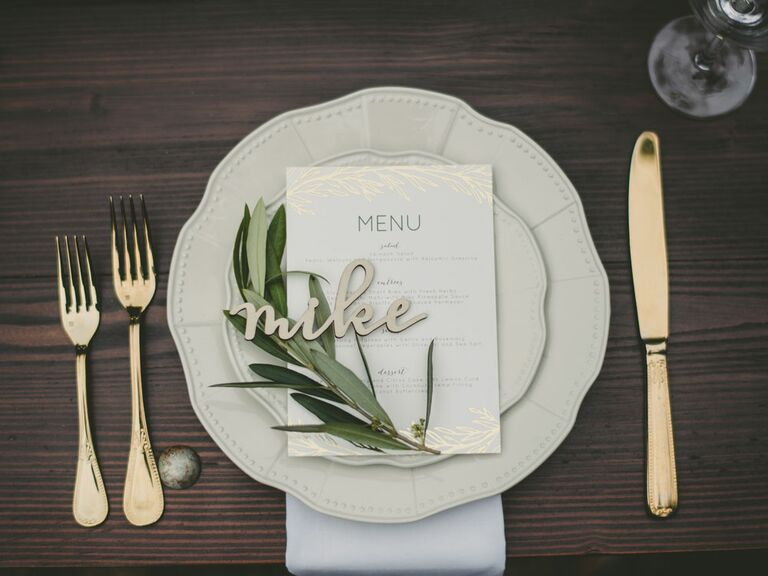 Rustic place setting with wood name card at barn wedding