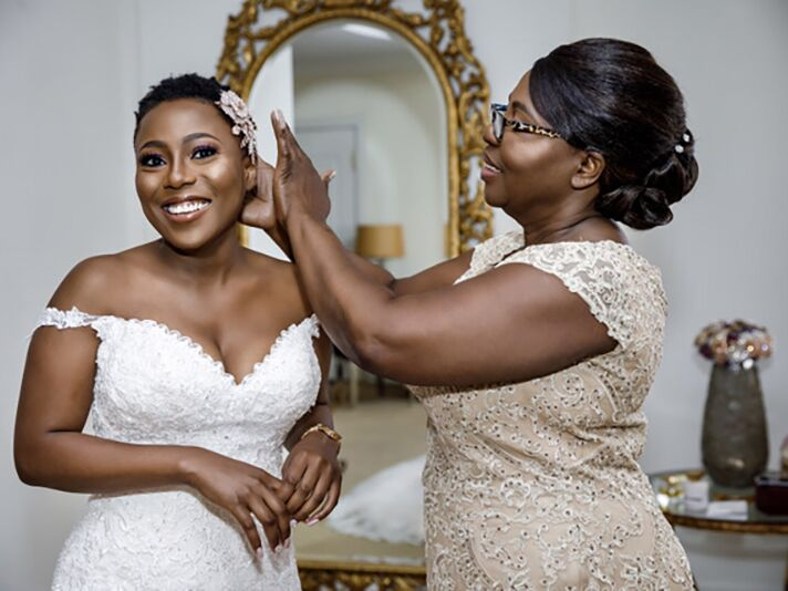 bride with mother getting ready