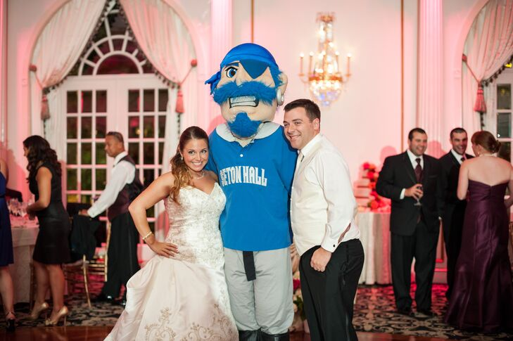 After getting married at Seton Hall University's chapel, it was only fitting that they brought the school's mascot to their reception, at Crystal Plaza in Livingston, New Jersey. The pirate made a grand, surprise entrance before he posed with Michelle and Brad.
