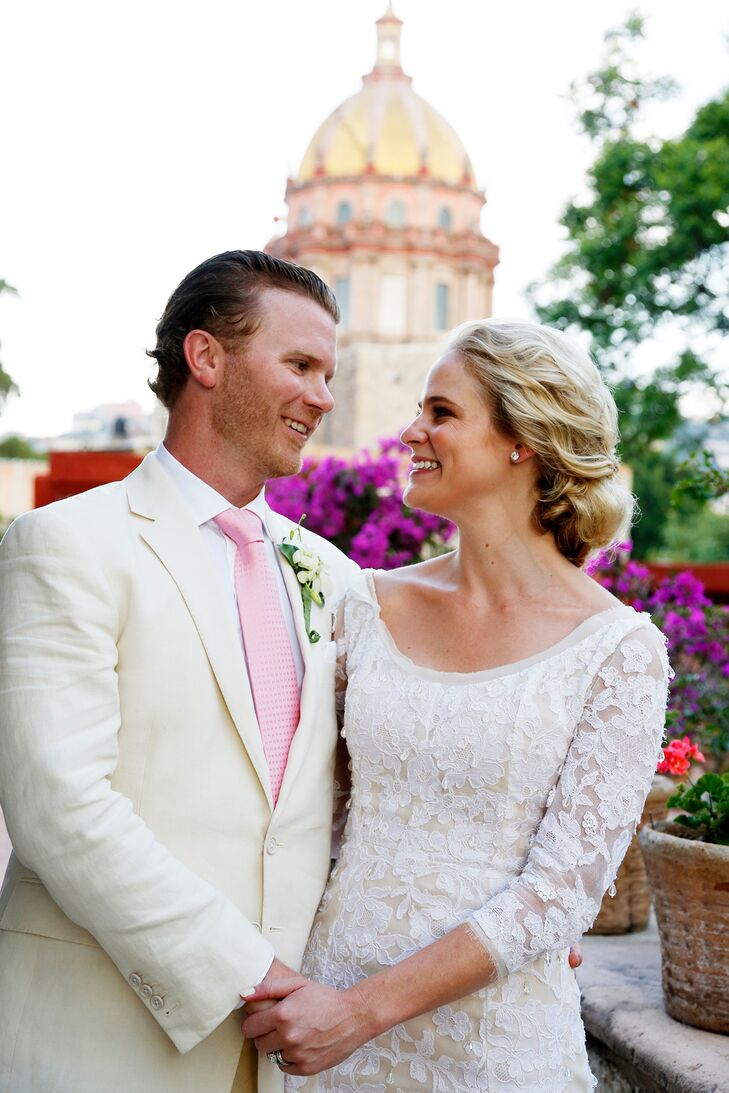 Joseph wore an ivory linen suit with a white shirt and pink tie to be light and festive for his Mexico destination wedding.