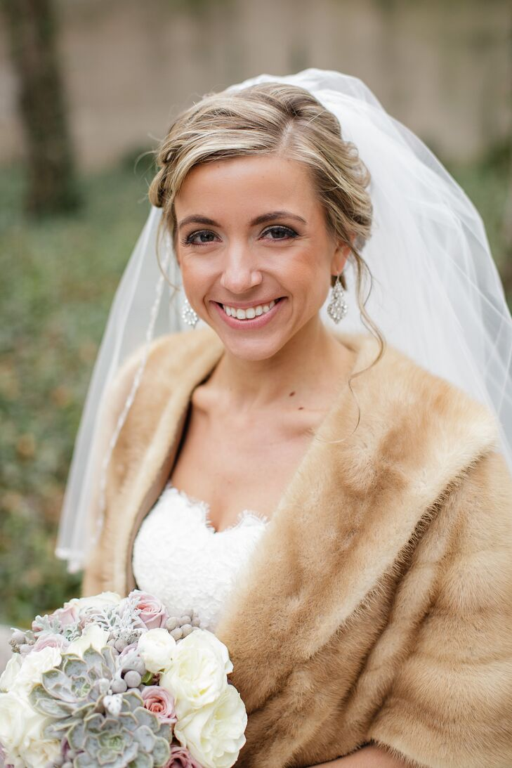 """The bride wore drop earrings and a swept-back hairstyle complete with soft waves. """"It was a wind-blown look that's not hard to get in the Windy City!"""" Amanda laughs."""