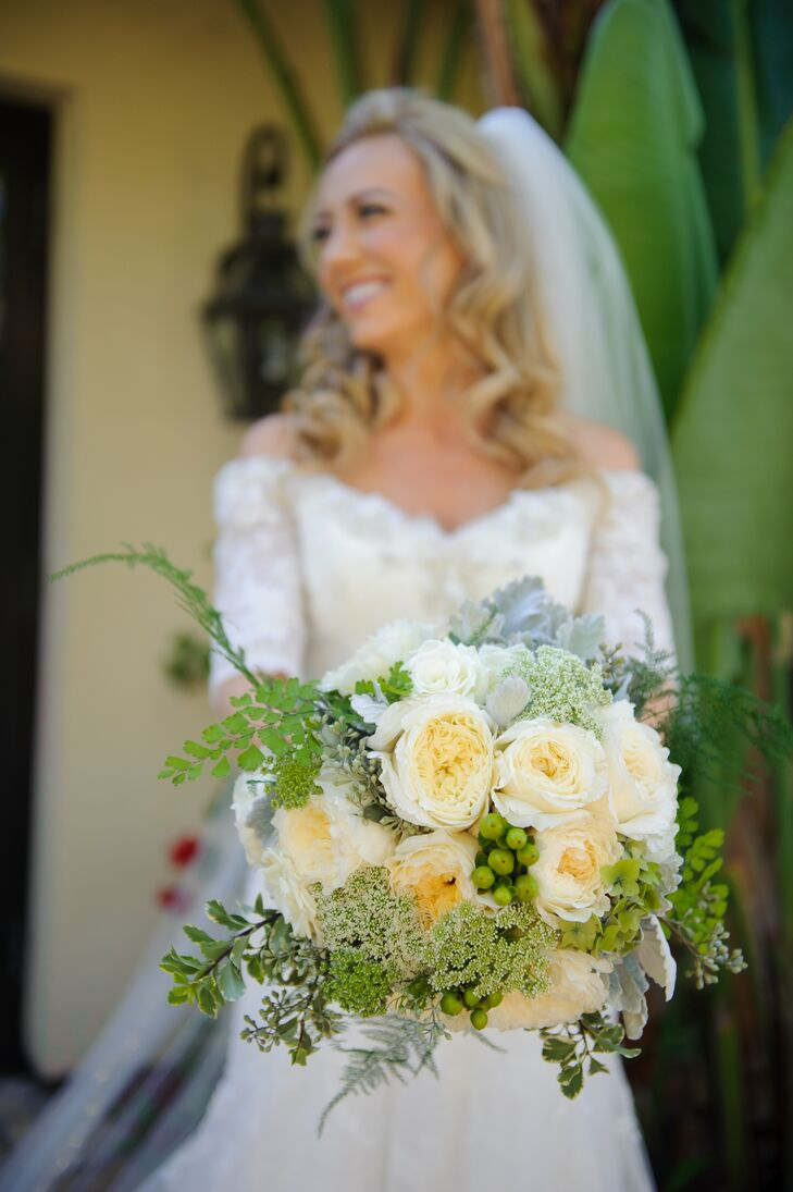 Jill held a bouquet filled with yellow and white roses accented with hypericum berries, Queen Anne's lace and other greens.