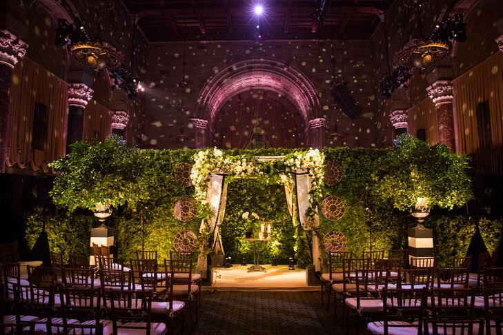 """""""The ceremony felt like a secret garden with a lot of greenery and natural wood,"""" Leigh notes. She and Micah were married under a birch wood huppah."""