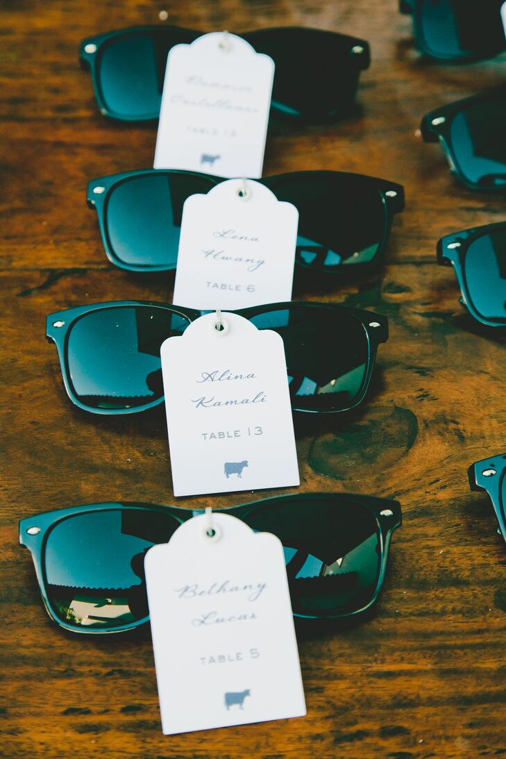 To add a touch of playfulness to the escort card display, the couple attached each guest's seating assignment to a pair of Wayfarer-inspired shades, which doubled as the favors. When guests headed to the dance floor after dinner, they put the stylish sunnies on show.