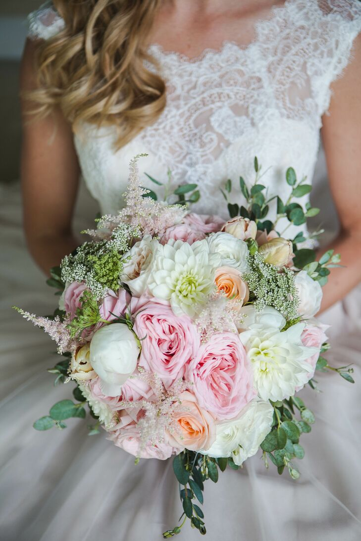 The bride's bouquet incorporated blush and ivory garden roses, tulips, ranunculus, peonies, dahlias, Queen Anne's lace and eucalyptus wrapped in ivory ribbon.