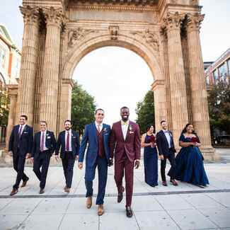 Grooms with wedding party