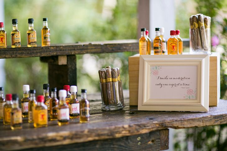 Gina and Kirby also had a cigar and miniature whiskey bottle bar for their guests to enjoy.