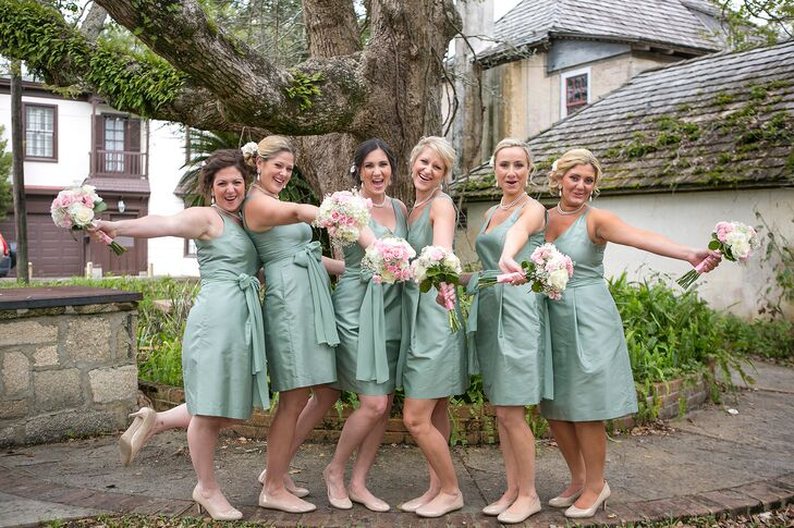 The bridesmaids wore sage green v-neck knee-length dresses from Ann Taylor paired with neutral shoes and pearl necklaces.