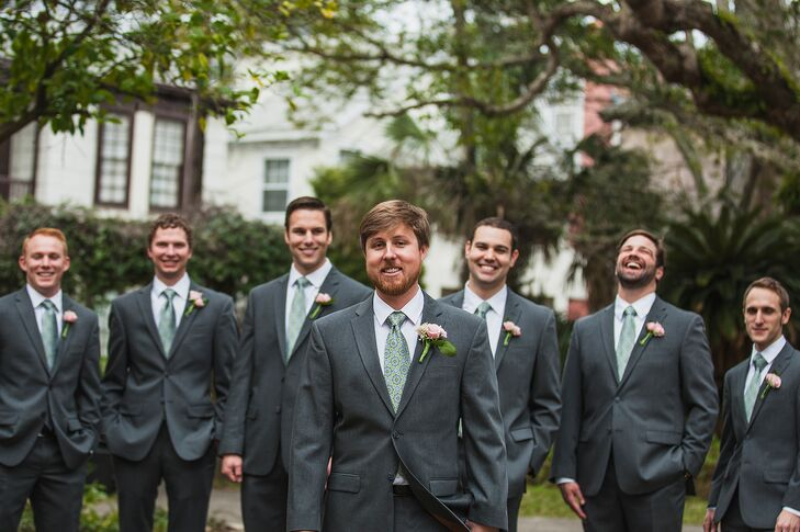 Kirby and his groomsmen were dressed in gray suits, sage and blue patterned ties, white shirts, and pink spray rose boutonnieres.