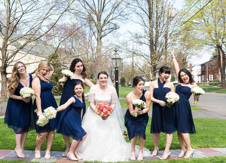 """The bridesmaids wore these short navy Dona Morgan dresses with flowing chiffon fabric. For Julia, the best part was the personalized details. """"Each girl could pick a different neckline,"""" says Julia. """"I just wanted everyone to feel comfortable and confident in what they were wearing."""""""