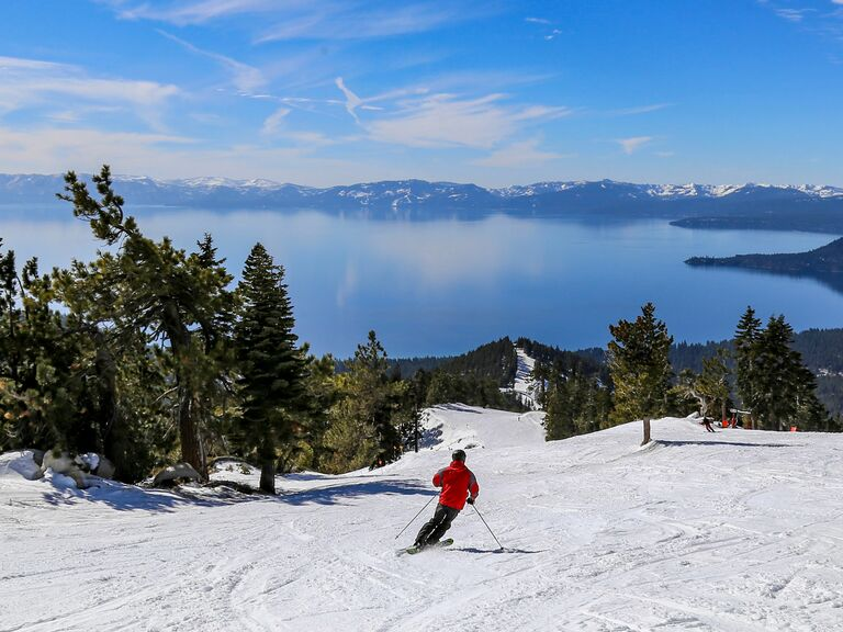 People skiing overlooking Lake Tahoe