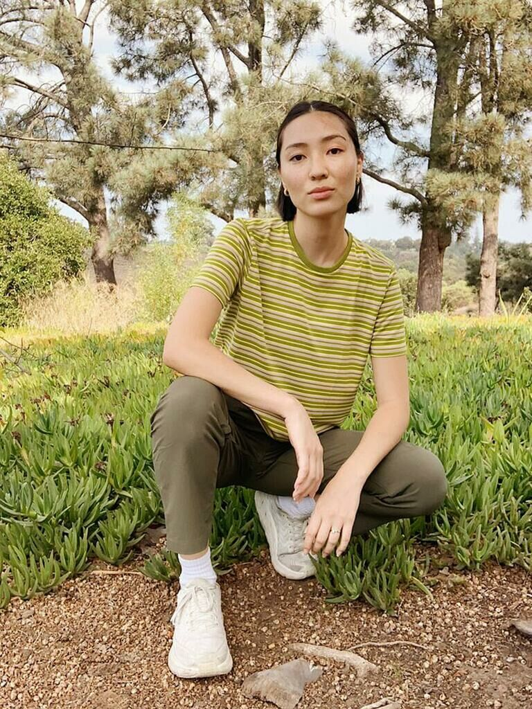 Woman wearing Rectrek pants outdoors with striped T-shirt