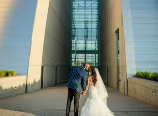 """The threat of torrential rain wasn't enough to prevent Krishelle Ricketts and Brandon Ivory from saying """"I do"""" in a rooftop ceremony high above Kansas"""