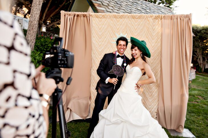 The bride and groom provided an open-air photo booth for their oceanside reception. Guests were allowed to keep one copy and asked to sign another for the bride and groom to keep.